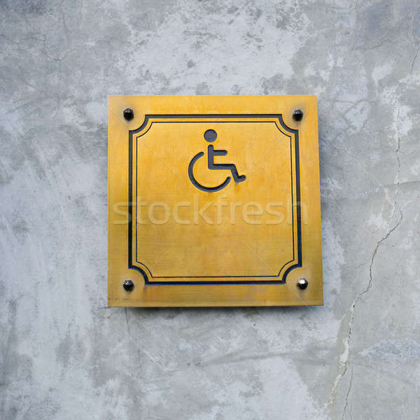 Disabled Handicap Icon Sign made from gold metal board Stock photo © art9858