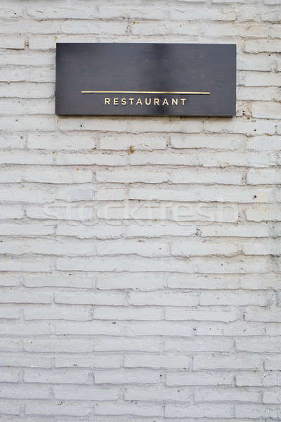 restaurant sign on black marble board on white brick wall Stock photo © art9858