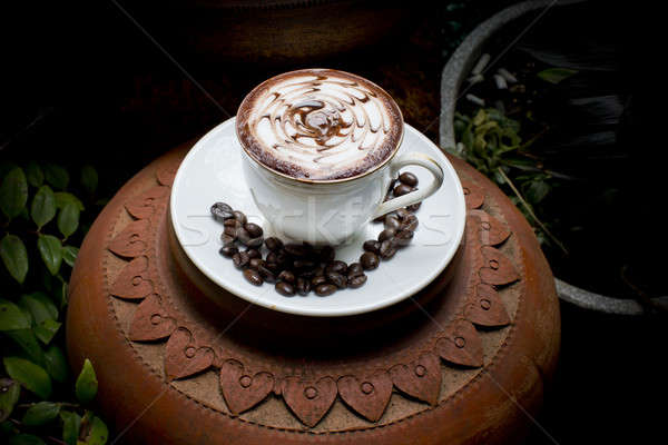 Art latte on hot coffee with coffee beans. Stock photo © art9858