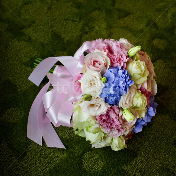 Bouquet of blooming colorful flowers on a green carpet backgroun Stock photo © art9858