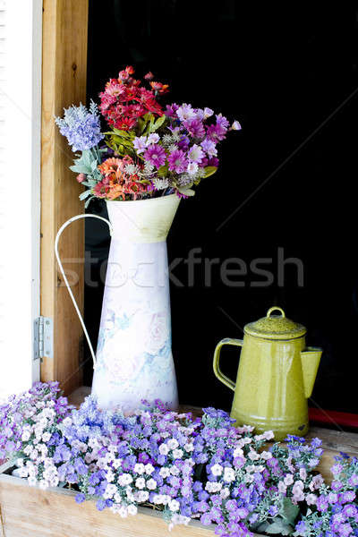 Beautiful flowers in white jug on wooden window Stock photo © art9858