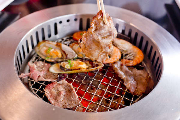 Mixed Roasted Meat and Seafood and Chopsticks on the BBQ Grill o Stock photo © art9858