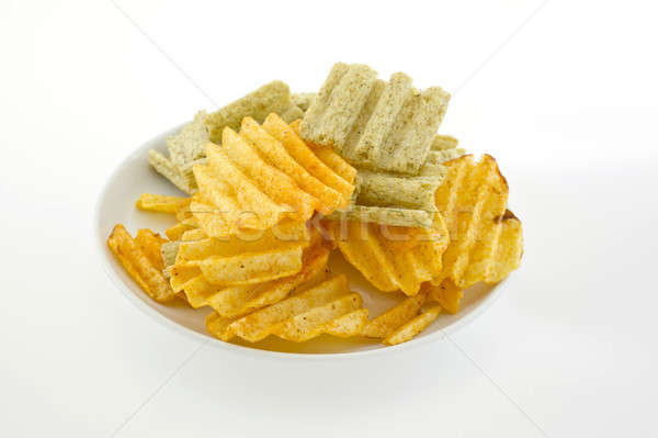 Mixed potato crisps and corn flake cereal on white background Stock photo © art9858