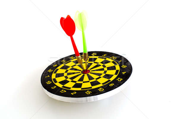 Two darts in center of target isolated on white Stock photo © art9858