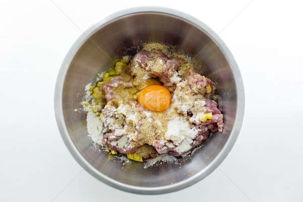 Minced meat,corns, eggs and flour in stainless steel bowl Stock photo © art9858
