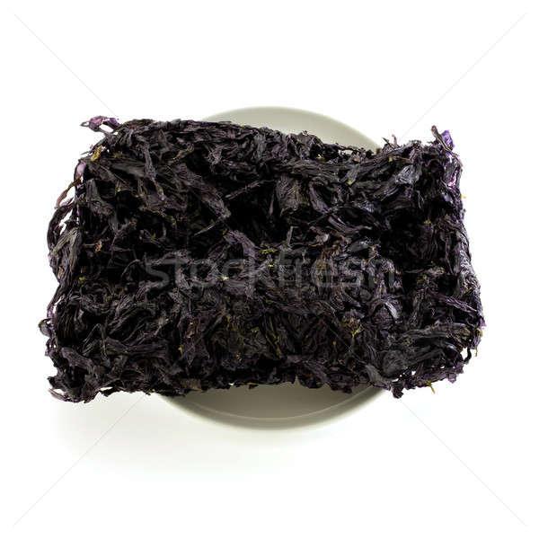 Gedroogd zwarte zeewier geïsoleerd witte Stockfoto © art9858
