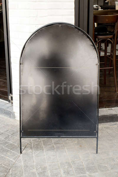 Blank black iron menu board with clipping path front of cafe Stock photo © art9858