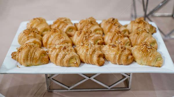 Fresco croissants torrado coco café da manhã pão Foto stock © art9858