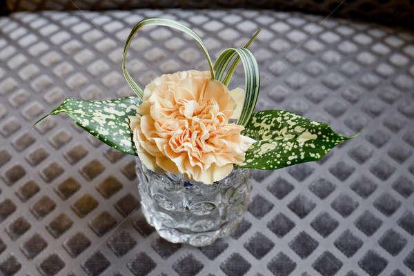 Glass vase with a single orange flower. Stock photo © art9858