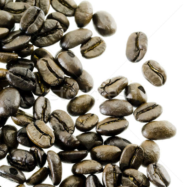 coffee beans spilling around isolated on Stock photo © art9858