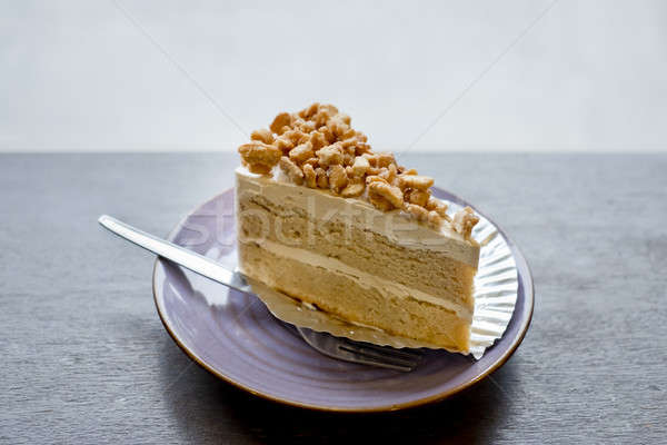 Piece of Coffee Cake with slice nuts topping. Stock photo © art9858