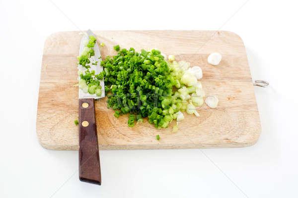 Primavera cebolla tabla de cortar cuchillo madera naturaleza Foto stock © art9858