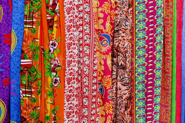 Rows of colourful silk scarfs hanging at a market stall in Thail Stock photo © art9858
