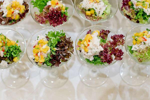 Appetizing salad in a transparent salad bowl, food closeup Stock photo © art9858
