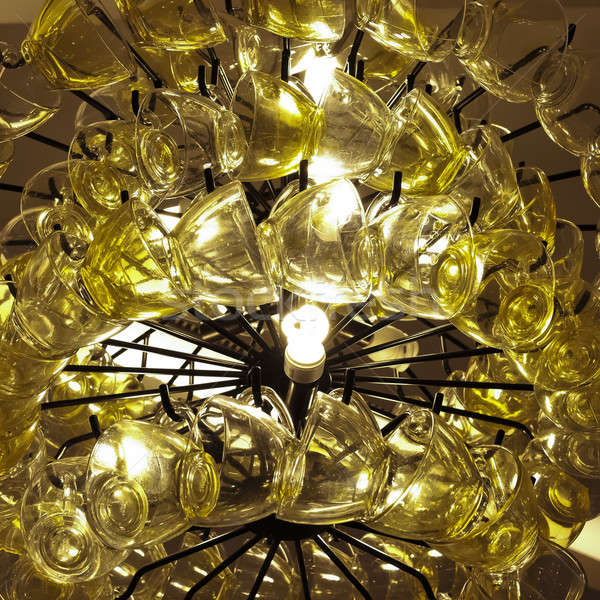 Close up Contemporary chandelier made of many yellow coffee cups Stock photo © art9858