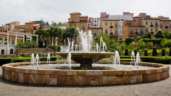 Big fountain with nice houses Tuscany Style and beautiful park Stock photo © art9858