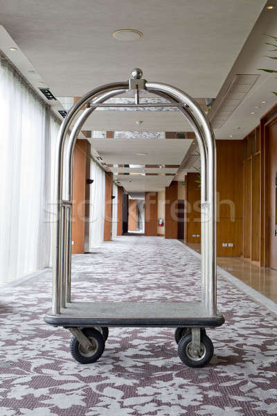 hotel luxury trolley barrow silver chrome parked at walkway in h Stock photo © art9858