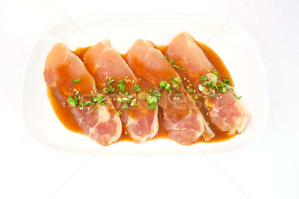 Fresh slices of chicken isoloate on white background ready to be Stock photo © art9858