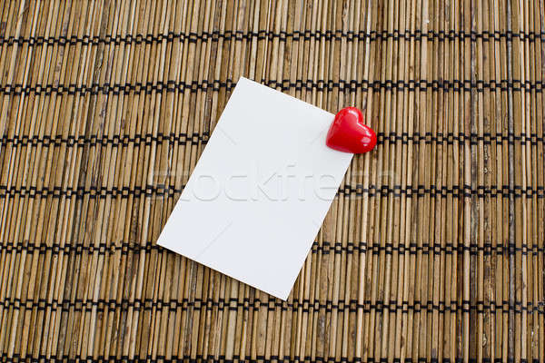notepad with clip of heart shape with red color on wood backgrou Stock photo © art9858