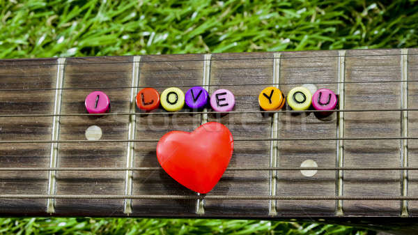heart on neck guitars and strings on the grass Stock photo © art9858