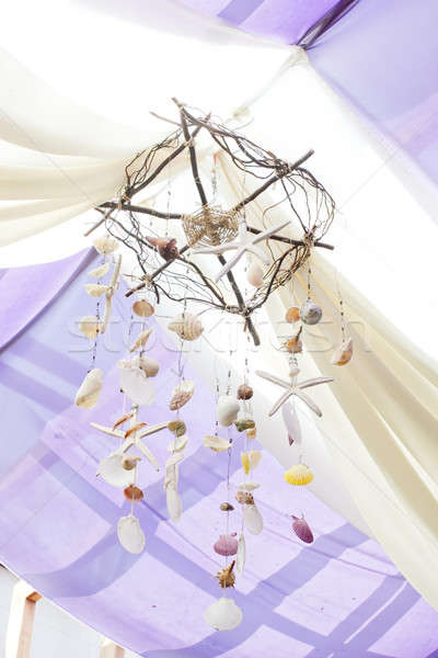 Seashells Mobile with white curtain on tropical resort Stock photo © art9858