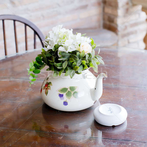 vase of beautiful flowers on coffee table - home decor Stock photo © art9858