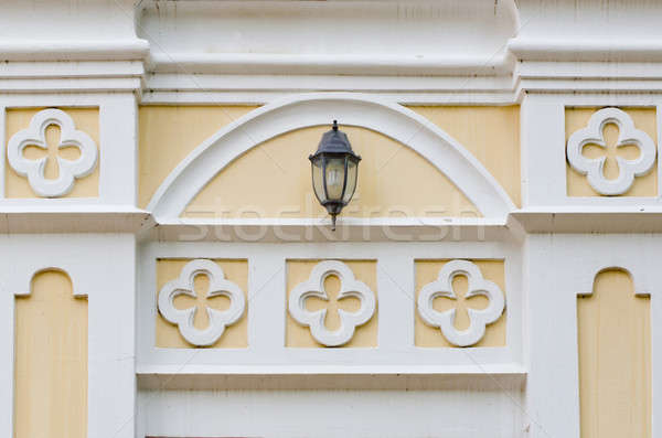 Gothic style wall outside house with vintage lantern. Stock photo © art9858
