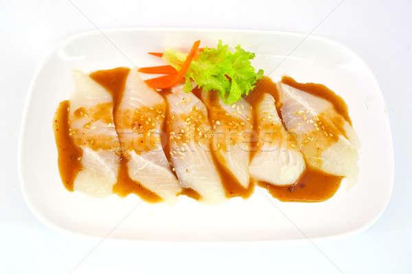 Fresh Dolly fish slice on white dish isolate on white background Stock photo © art9858