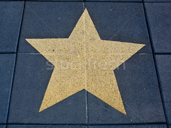 Dark blue brick floor with a painting of a big gold star. Stock photo © art9858