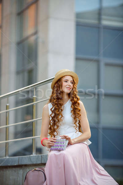 Portrait of a beautiful european woman sitting om steps Stock photo © artfotodima