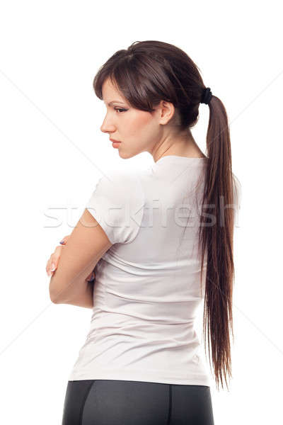 Portrait of upset woman against white background Stock photo © artfotodima