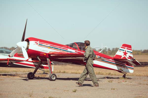 Pilot in front of vintage plane Stock photo © artfotodima