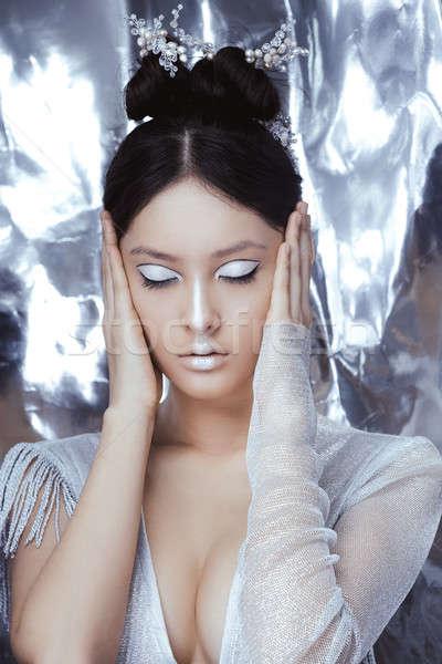 Shot of a futuristic young asian woman. Stock photo © artfotodima