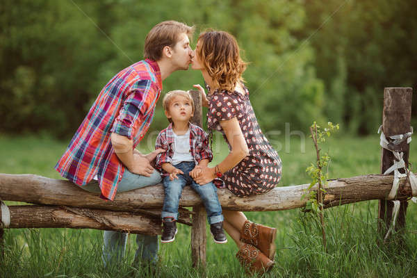 Happy family in a park Stock photo © artfotodima