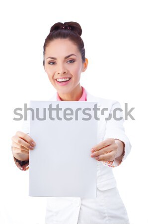 Smiling businesswoman holding blank whiteboard sign. All isolated on white background. Stock photo © artfotodima