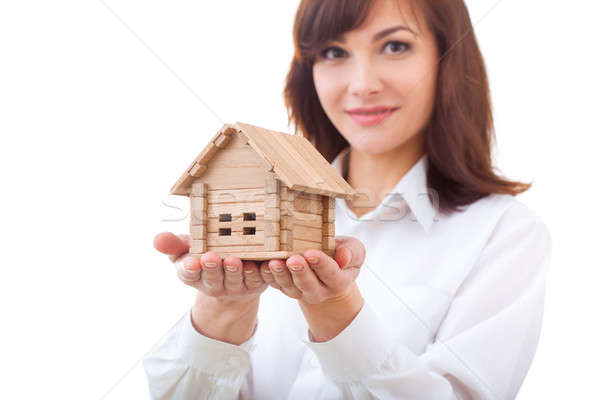 adult realtor with wooden toy house,it could be the tenant too. All isolated on white background. Stock photo © artfotodima