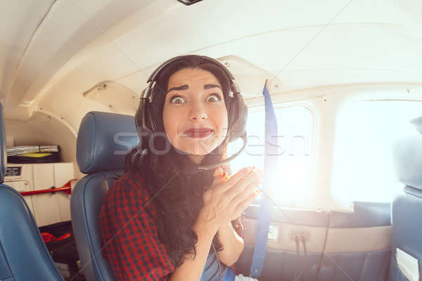 Fear of flying woman Stock photo © artfotodima