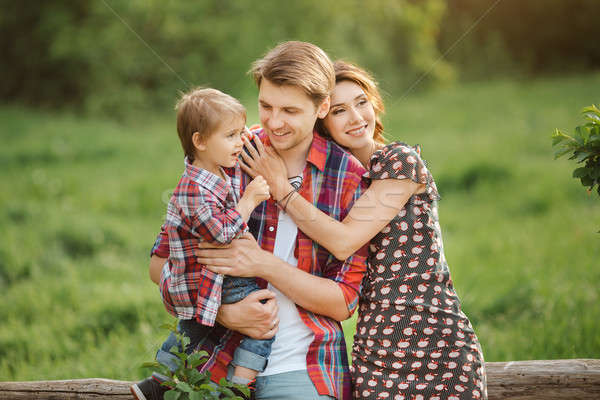 Stock photo: Happy family in a park