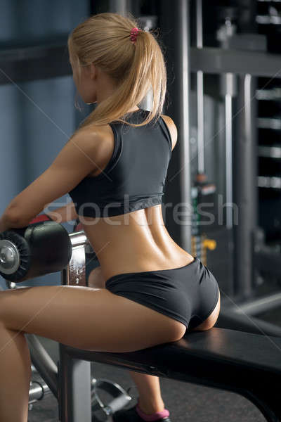 Brutal athletic woman resting on bench Stock photo © artfotodima