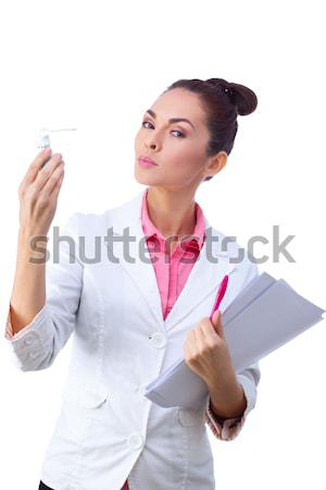 Friendly woman holding papers. All isolated on white background. Stock photo © artfotodima