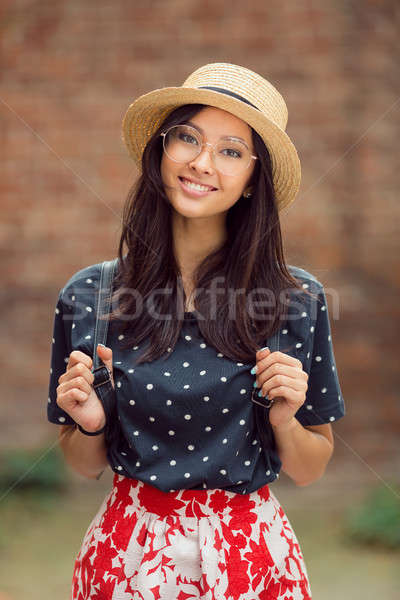 Portrait of a mixed race college student girl at campus outdoors Stock photo © artfotodima