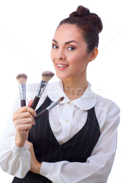 Woman with makeup brushes.  All isolated on white background. Stock photo © artfotodima