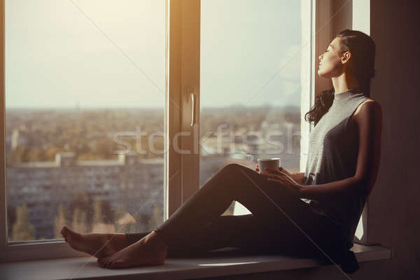 Girl resting and thinking at home Stock photo © artfotodima