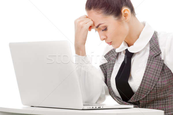 Tired overworked freelancer working with a laptop Stock photo © artfotodima