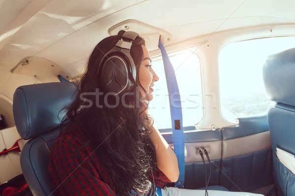 Stock photo: Airplane woman passenger