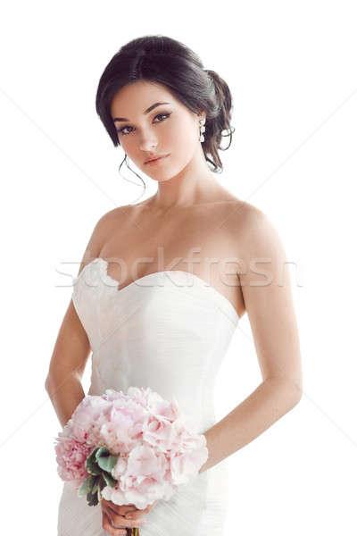 Beautiful brunette woman as bride with pink wedding bouquet on white Stock photo © artfotodima