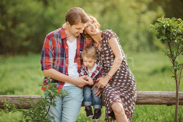 Happy family in a park Stock photo © artfotodima