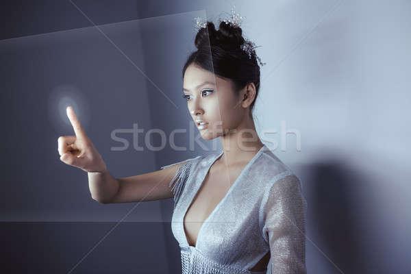 Futuro jovem bastante asiático mulher tocante Foto stock © artfotodima