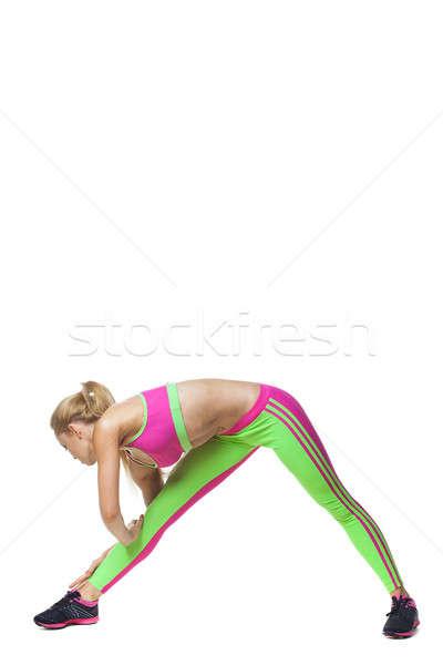 Fitnessz nő nyújtás testmozgás fiatal nő rugalmasság izolált Stock fotó © artfotodima