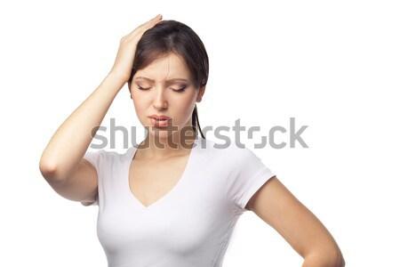 Headache concept - young woman suffering a migraine Stock photo © artfotodima